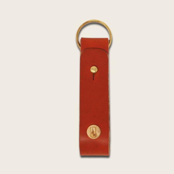 Porte-clés, en cuir naturel à tannage végétal et bois, orange