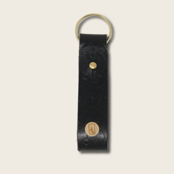 Porte-clés, en cuir naturel à tannage végétal et bois, noir imprimé autruche